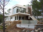 Spanish property for sale in: Sitges the surrounding hills. Stylish modern villa with undisturbed views